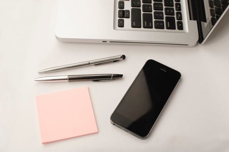 laptop and phone on a white table digital marketing agency montreal